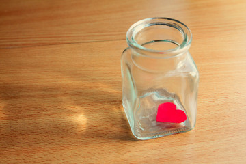 Heart trapped in a glass jar