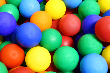 colored balls with very vivid colors into a pool of balls