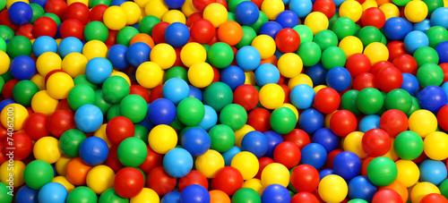 Leinwanddruck Bild colored plastic ball in the game pool
