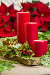 Red candle centerpiece with greens