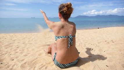 Woman Relaxing on Beach. Freedom, Vacation, Pleasure Concept.