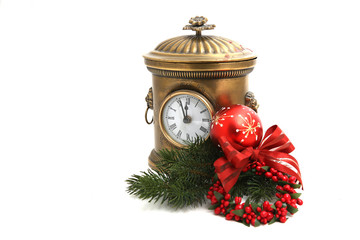Old vintage clock decorated with Christmas ball