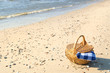 Picnic basket at the beach - 74063266