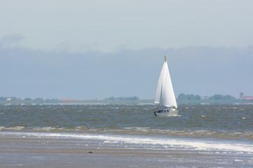Sailboat on Dutch wadden sea