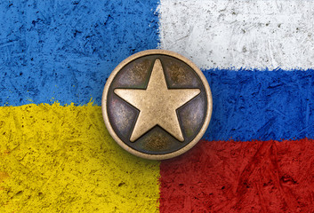 Bronze star on Ukranian and Russian flags in background