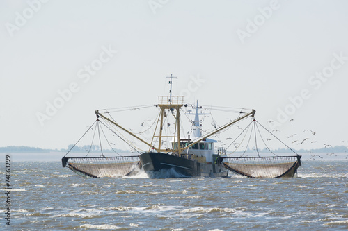 fishing boat on Dutch wadden sea - 74063299