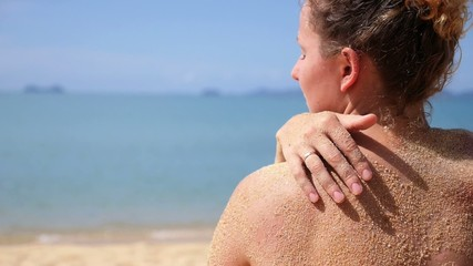 Female Back and Shoulder against Sea on Beach. Slow Motion.