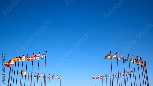 international flags against the sky - 74065017