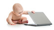 funny baby playing on notebook
