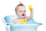 adorable child taking bath in blue tub