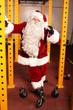 Santa Claus preparing for Christamas time in gym