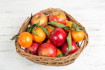 basket of apples and mandarins