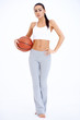 Woman in Workout Outfit Holding Basketball Ball