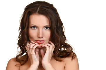 brunette woman with  curly silky hair studio shot
