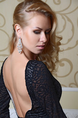 beautiful sexy woman with blond hair in elegant black dress