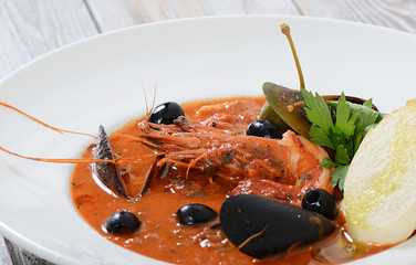 Tomato soup with fish and seafood