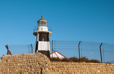 Old lighthouse in the city of Acre in Israel