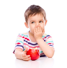 Cute boy with red apples