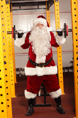 Santa Claus lifting weights - training before Christmas