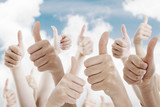 Many people holding their thumbs up - 74070675
