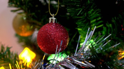Christmas and New Year Decoration. Bauble on Christmas Tree.