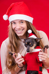 Teenage girl with dog in Christmas portrait