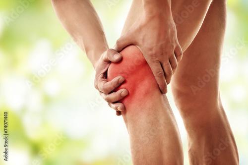 Leinwanddruck Bild Schmerzen im Knie