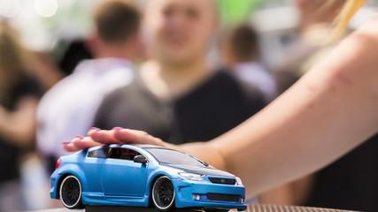 Girl Stroking A Toy Car