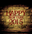 happy new year 2015 blood text at the brick wall with dim light