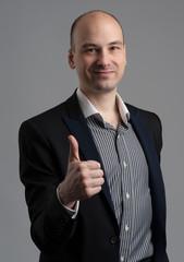 fashionable man showing his thumb up