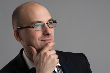thoughtful businessman wearing glasses