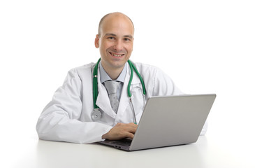 handsome doktor sitting at a desk with laptop
