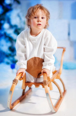 Boy portrait  in the snow studio