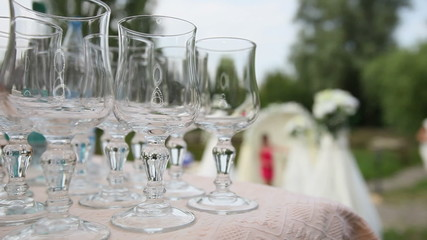 glasses with champagne on wedding table close up