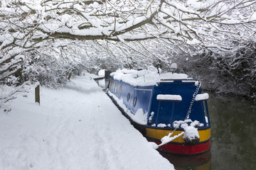 Deep snow lines a canal near Oxford