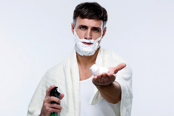 Man with shaving cream over gray background