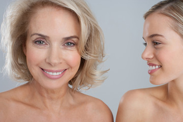 Portrait of smiling bare chested mother and daughter