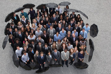 Business people with umbrellas