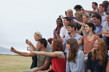 Group of spectators taking photographs