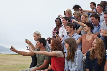 Group of spectators taking photographs