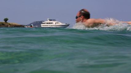 Man swims butterfly in the Aegean Sea.