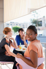 Women having lunch together at cafe