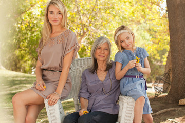 Three generations of women relaxing outdoors