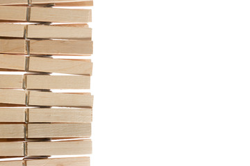 wooden pegs isolated on white