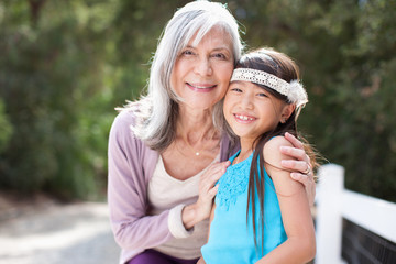 Older woman and granddaughter smiling together