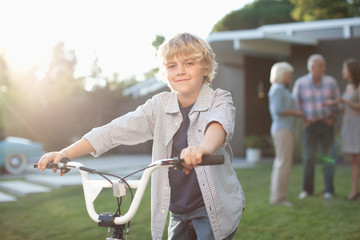 Boy riding bicycle outdoors