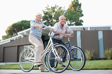 Older couple riding bicycles together