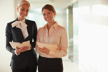 Businesswomen standing together in office