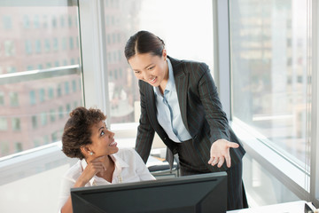 Businesswomen working together in office