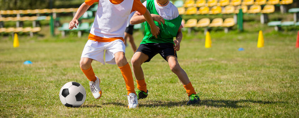 Soccer football game for children. Kids playing football soccer